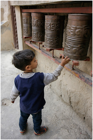 The child with prayer wheel