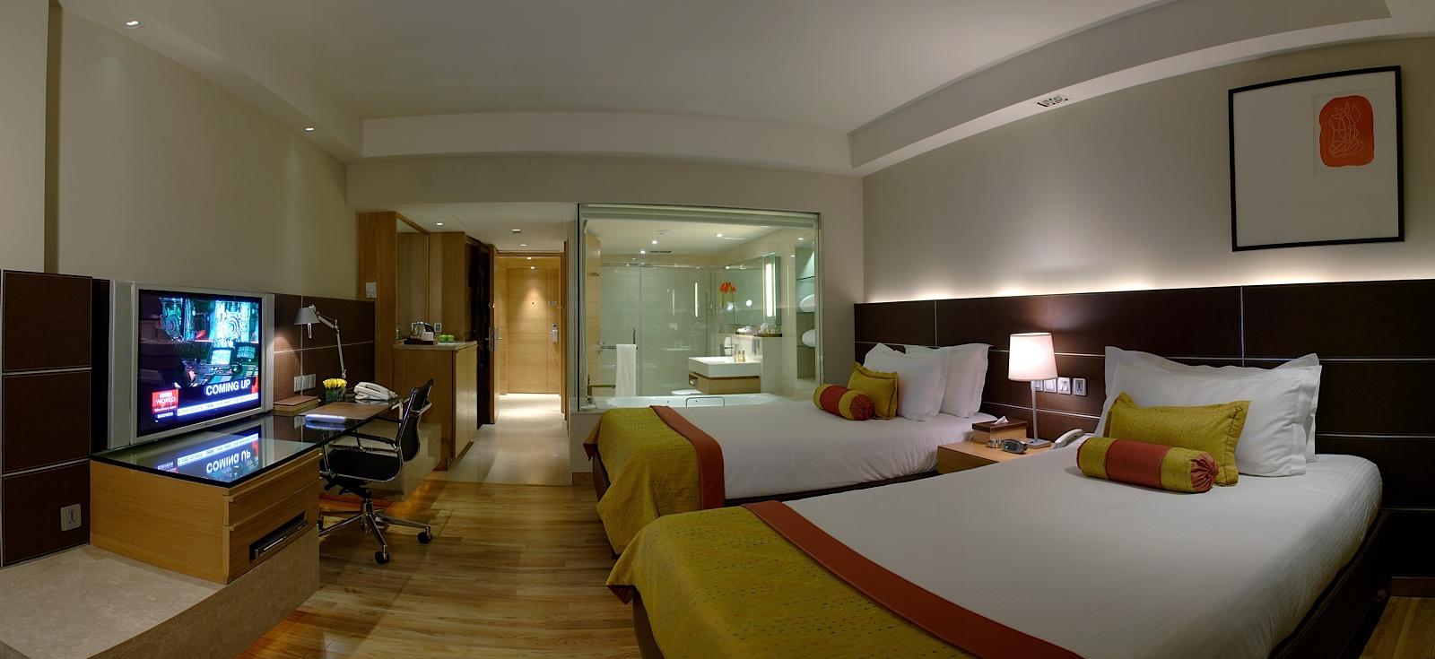 Hoteles the lalit en india visi n cosmopolita y fresca for Imagenes de habitaciones de hoteles de lujo