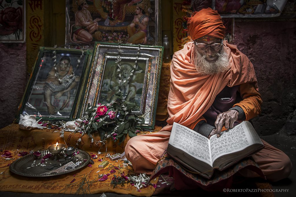 Sadhu reading book in Varanasi