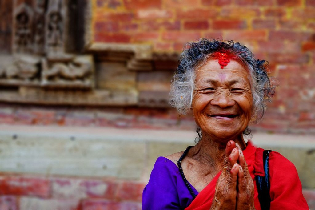 Nepali woman waving