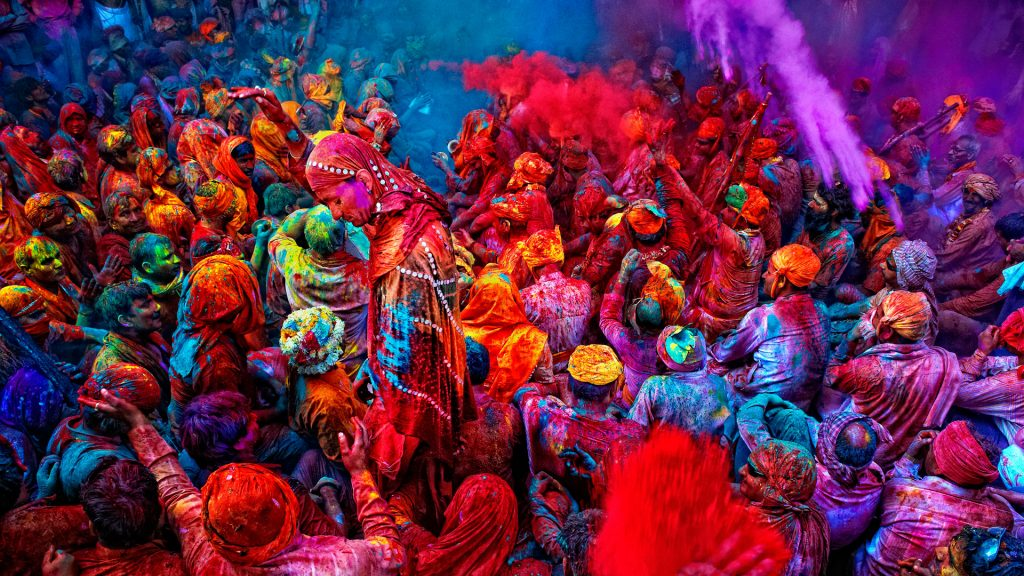 Man full of colors during Holi celebration in India