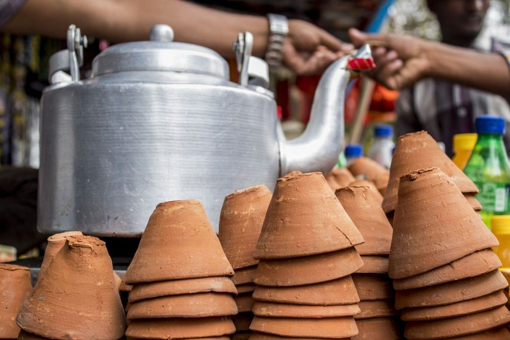 Teapot and clay cups in an Indian market