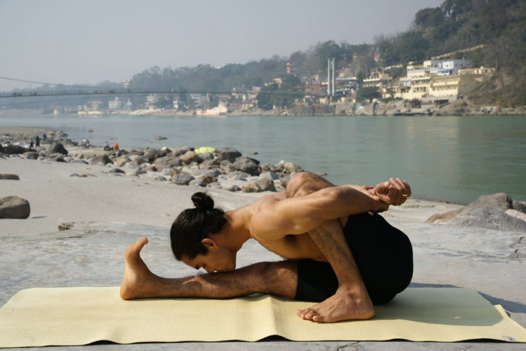 Doing yoga in Rishikesh