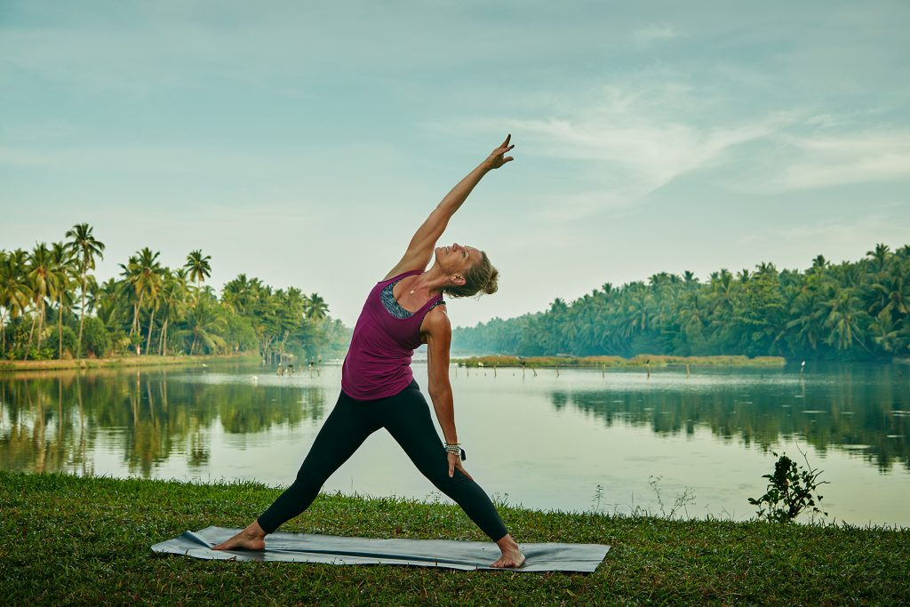 Yoga among the coconut trees of Kerala