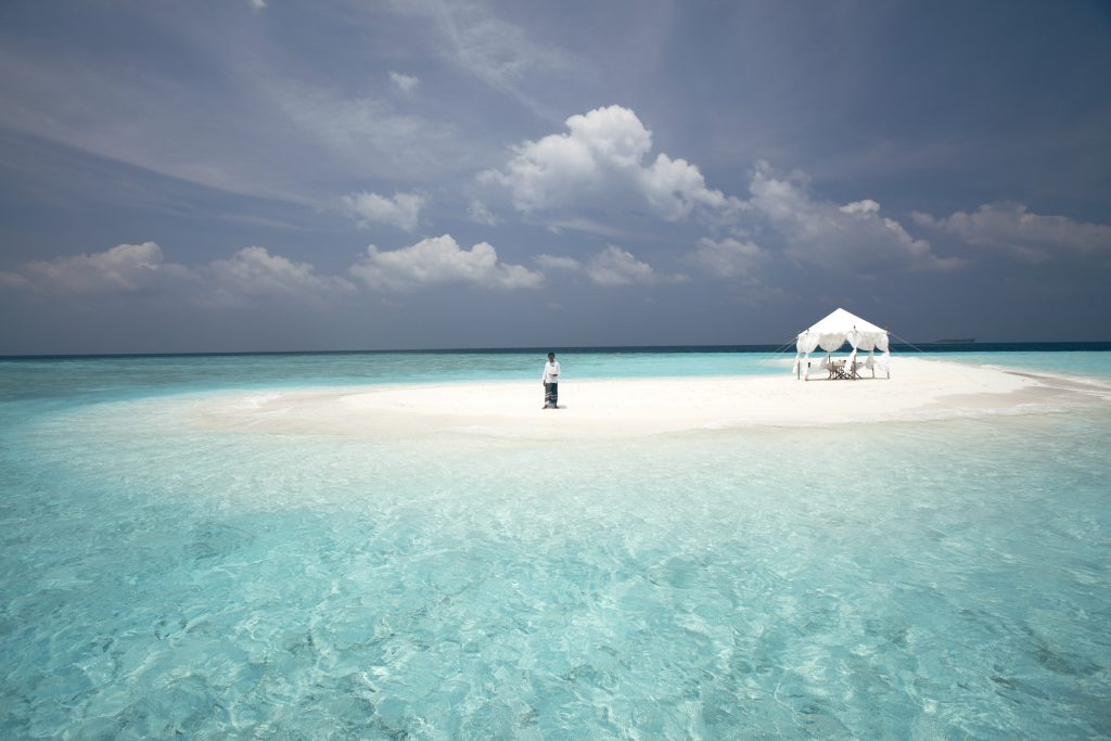 Man in the Sandbank of Baros Maldives