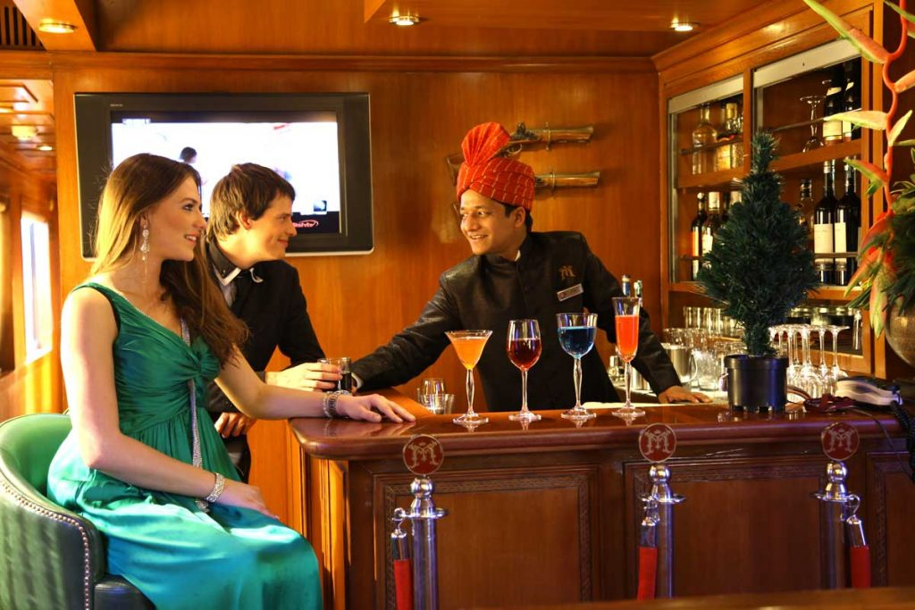 Travelers at the Maharaja Express bar