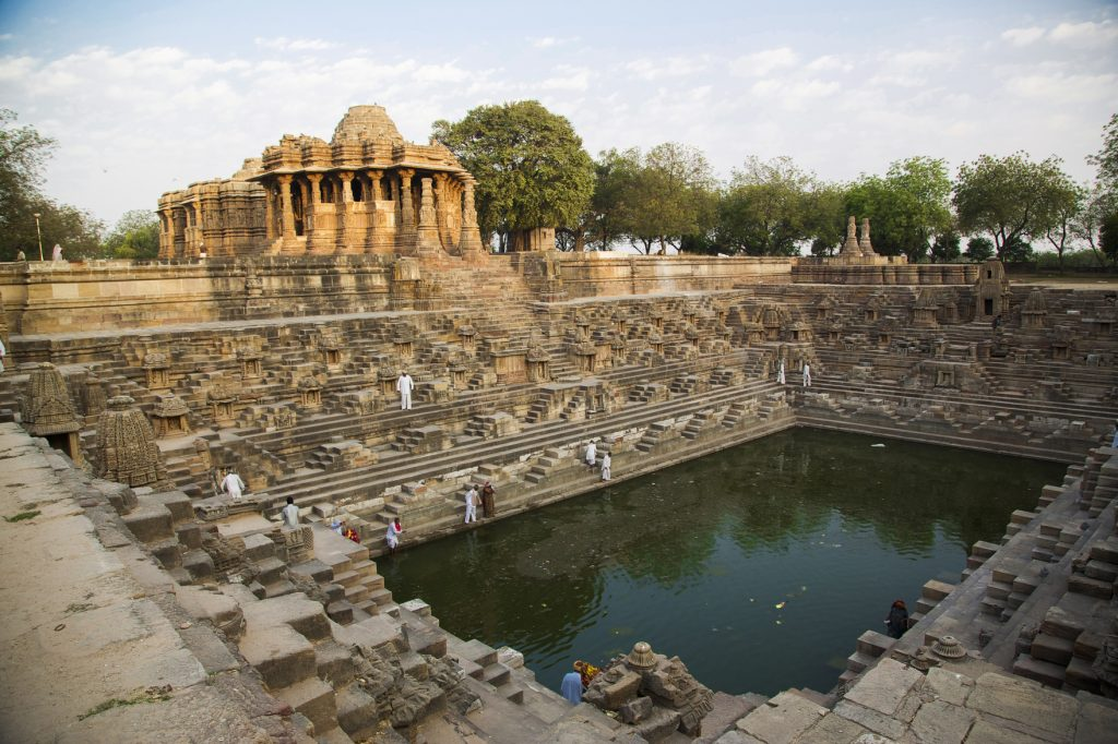Visitors in the baori or kundar of the Sun Temple of Modhera