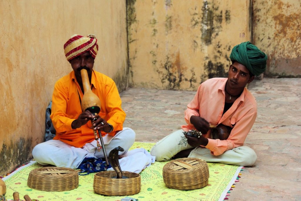 Two snake charmers in India