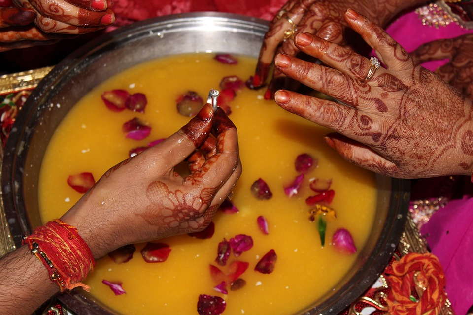 Holy water pot and exchange of rings in Indian wedding