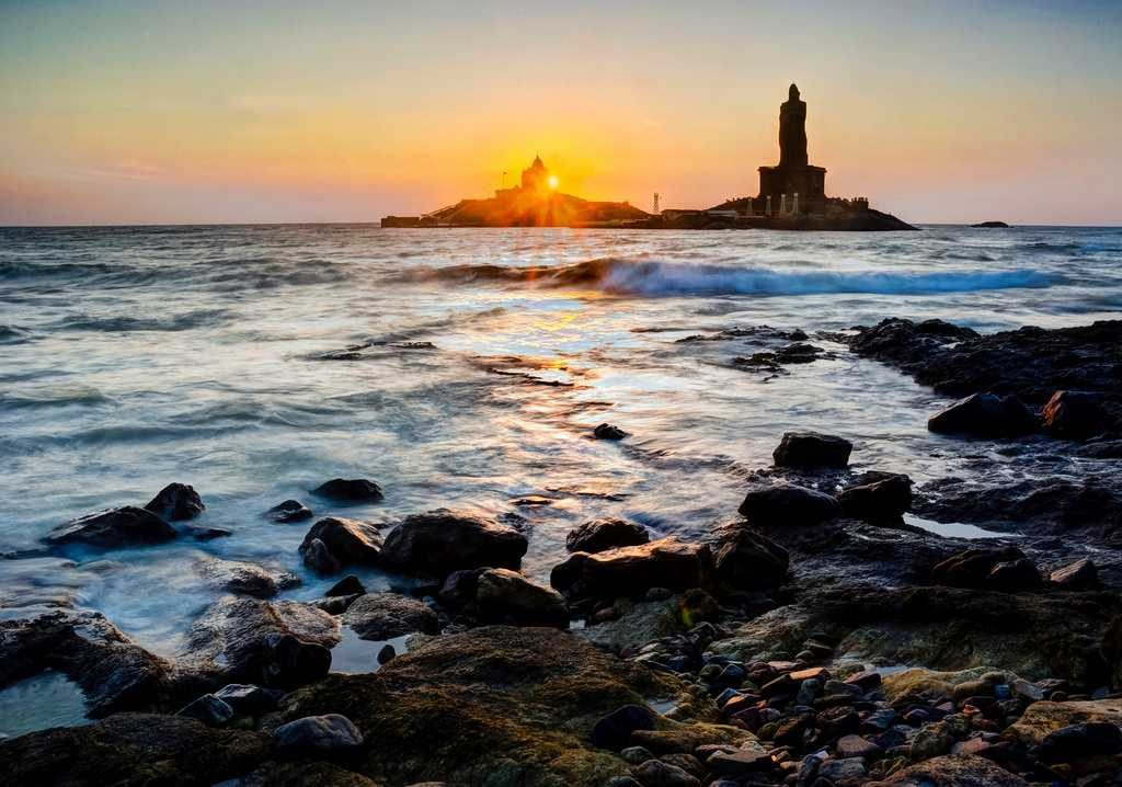 Thrivulluvar statue next to sunset in Kanyakumari Kerala