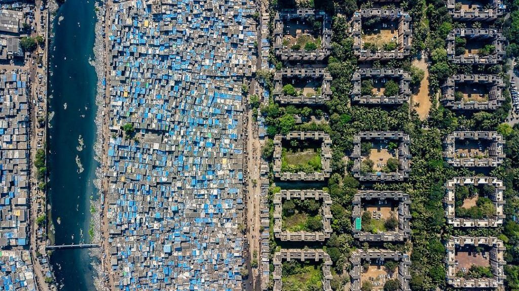 Slum and neighborhoods of Mumbai seen from the air with drone