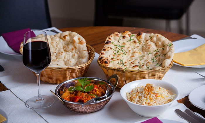 Indian food dishes with red wine