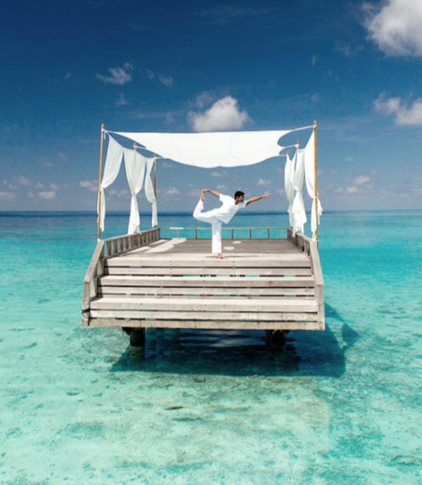 Yoga in Piano Deck by Baros Maldives in Maldives