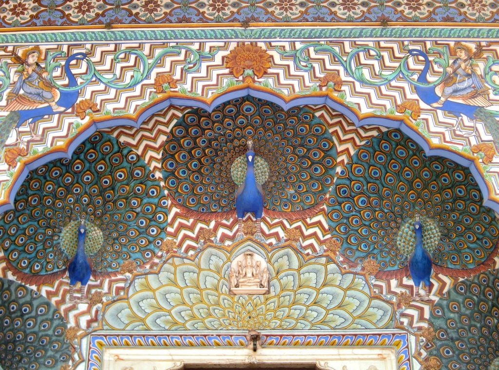 Peacocks on the facade of the City Palace of Jaipur